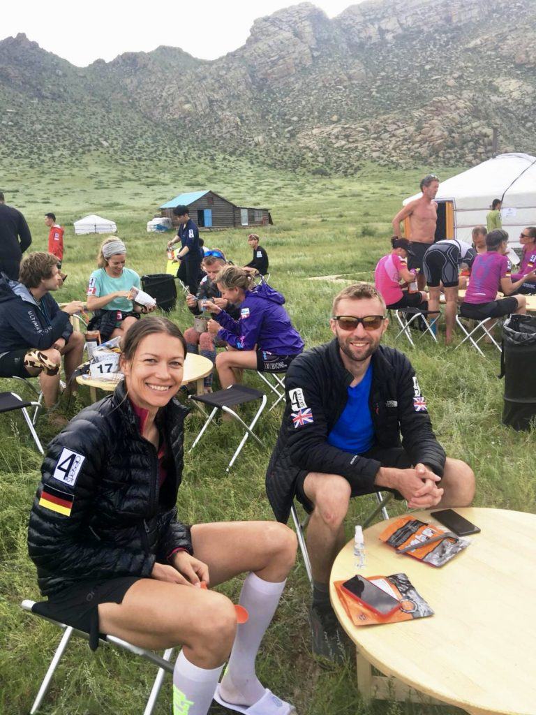 Runners eating dinner at camp during the Gobi March