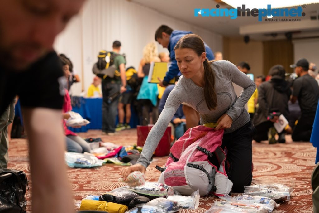 Competitor with gear and backpack at gear check for the Gobi March