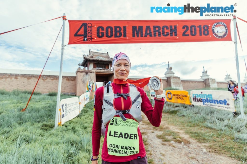 Female winner Angela Zaeh at the finish line of the Gobi March 2018